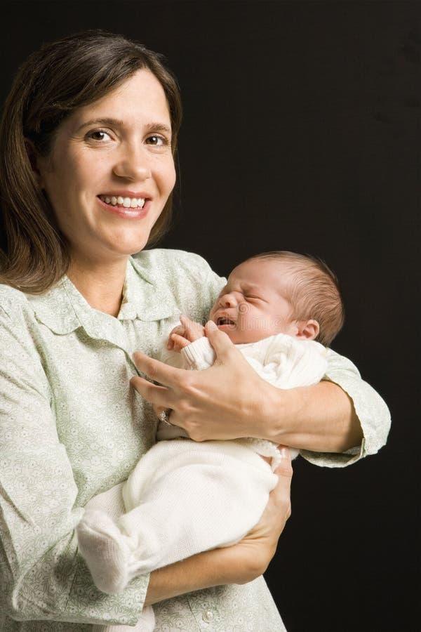 Generi il bambino della holding. fotografie stock