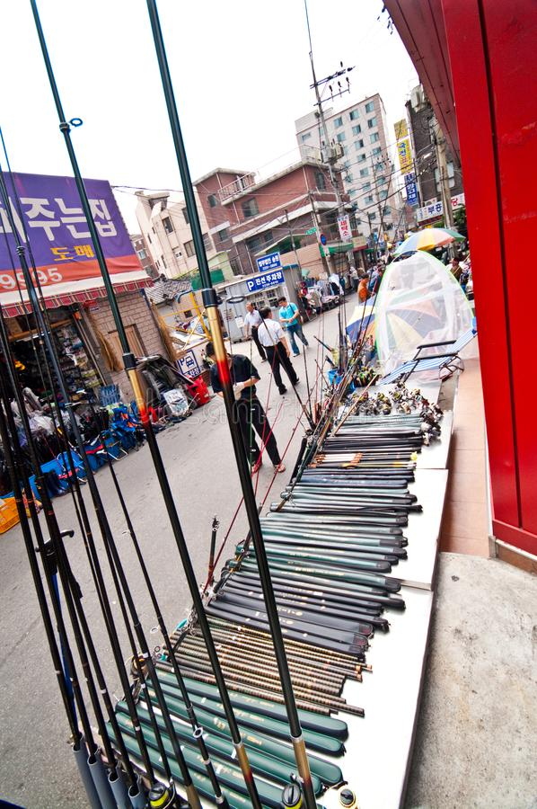 Seoul South Korea street generic architecture. Generic architecture of one of Seoul South Korea streets, street vendor offering fishing rods and accessories stock photography