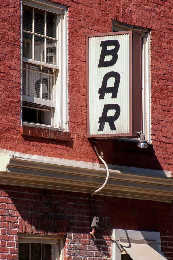Generic Bar sign. Outside neighborhood dive bar in the city stock image