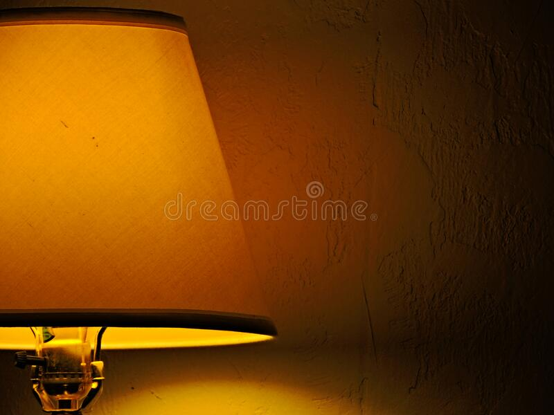 A Generic Lampshade With Soft Yellow Lighting stock photo