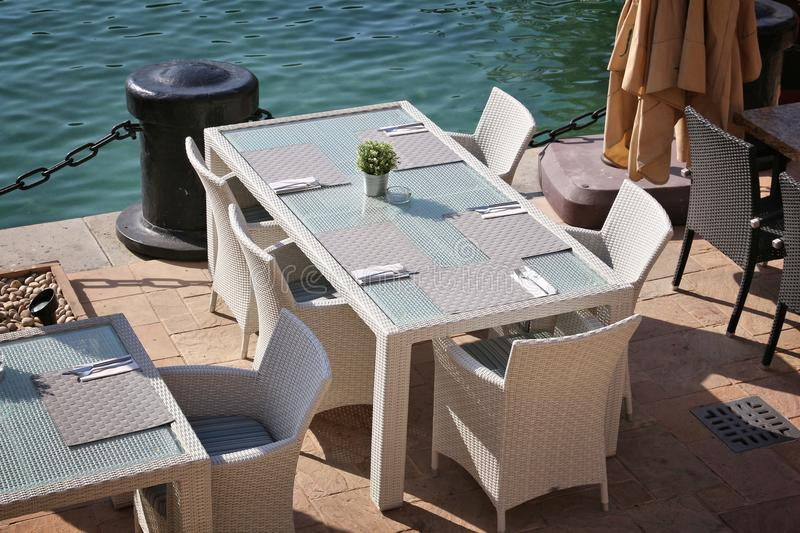 Generic modern restaurant. Outdoor tables in Dubai. Synthetic rattan furniture stock image