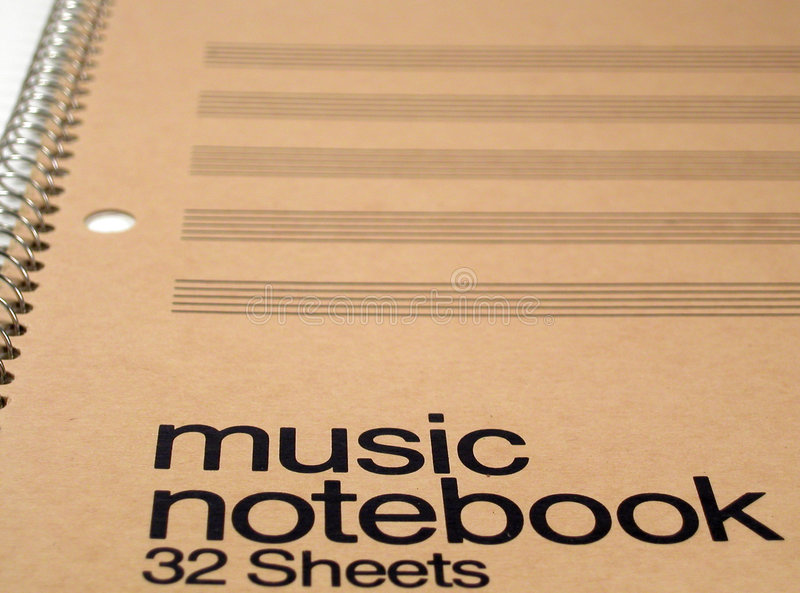 Generic Music Notebook. A notebook of blank five-line staffs for composing music. Focus is on the words, with the rest blurred royalty free stock photo