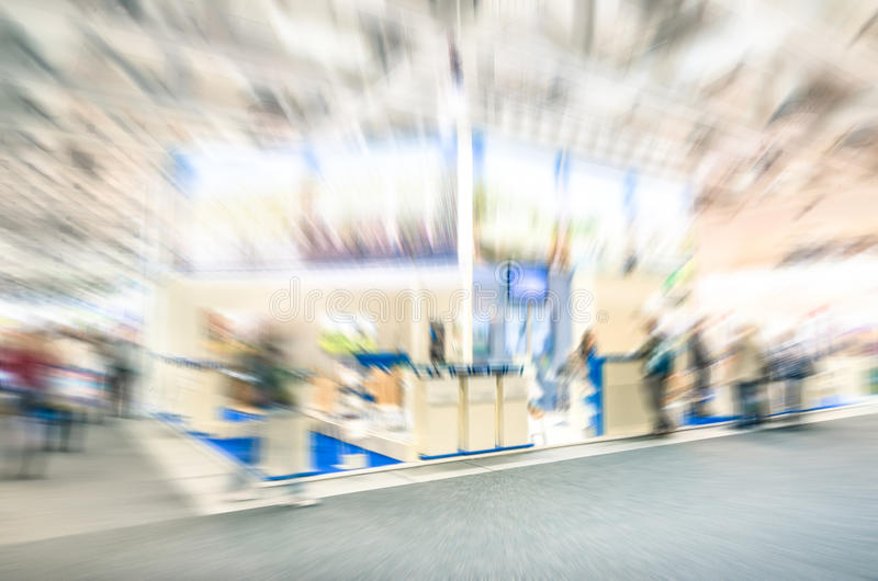 Generic trade show stand with blurred zoom defocusing. Concept of business social gathering for international meeting exchange royalty free stock photography