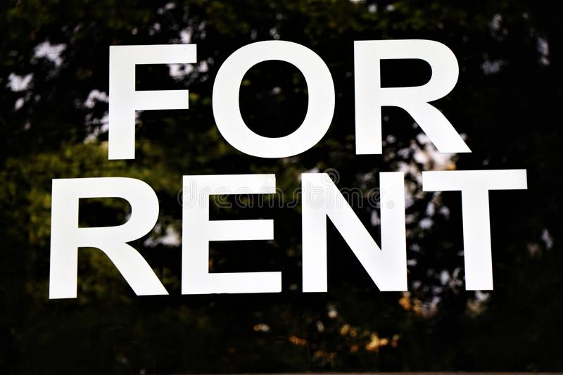 Generical written `For Rent`. Located in a window shop. Signboard with the written `For Rent royalty free stock image