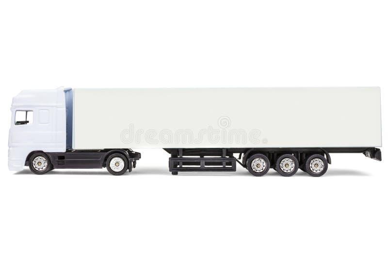 Witte lege stuk speelgoed ladingsvrachtwagen die op wit wordt geïsoleerdi stock foto's