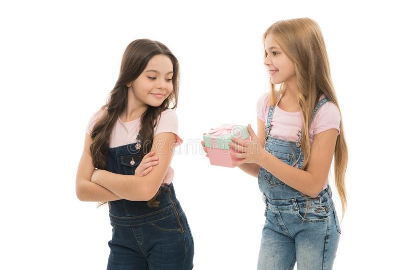 She is a generous giver. Adorable little giver and taker girls. Small cute gift giver presenting box to sister or friend. It is the giver not the gift that is royalty free stock images