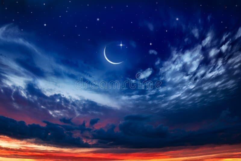 Generous Ramadan . New moon. Prayer time. Beautiful dark fluffy cloudy sky with sun rays . Crescent moon with beautiful sunset background . Generous Ramadan royalty free stock photos