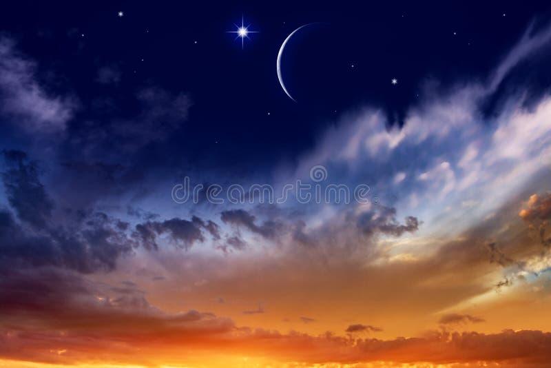 Generous Ramadan . New moon. Prayer time. Beautiful dark fluffy cloudy sky with sun rays . Crescent moon with beautiful sunset background . Generous Ramadan stock images