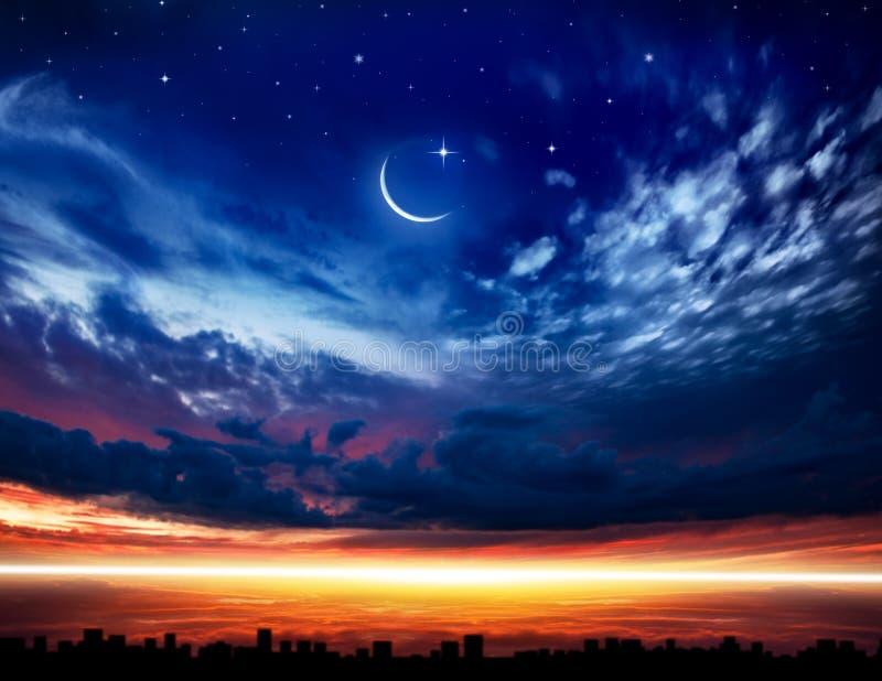 Generous Ramadan . New moon. Prayer time. Beautiful dark fluffy cloudy sky with sun rays . Crescent moon with beautiful sunset background . Generous Ramadan stock image