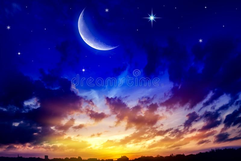 Generous Ramadan . New moon. Prayer time. Beautiful dark fluffy cloudy sky with sun rays . Crescent moon with beautiful sunset background . Generous Ramadan royalty free stock photography