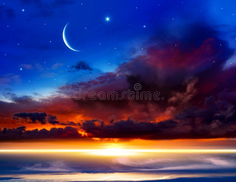 Generous Ramadan . New moon. Prayer time. Beautiful dark fluffy cloudy sky with sun rays . Crescent moon with beautiful sunset background . Generous Ramadan royalty free stock images