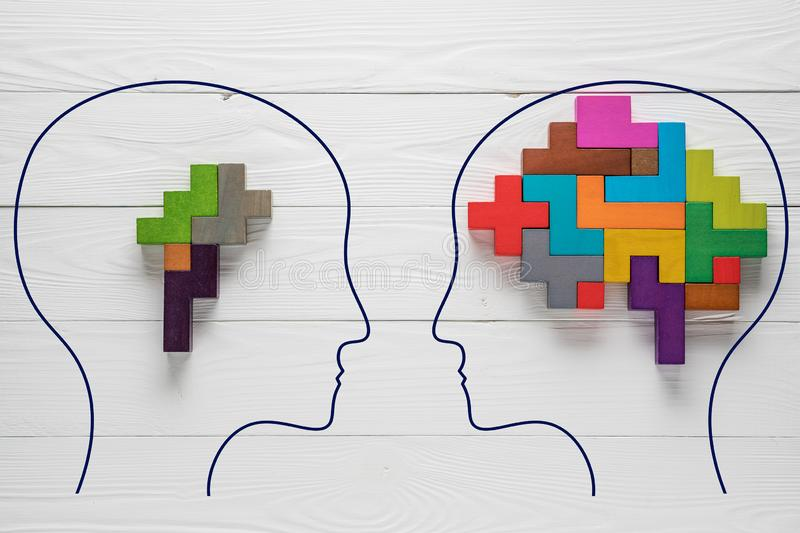 Genetic Brain disorder. Health and ailing brain. Mental health and mental disorder concept. Heads with shapes of abstract brain. T royalty free stock photography