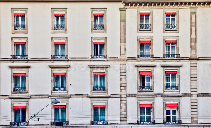 Geneva Cityscape - Row of Old Windows. Rows of old windows at a building in Geneva, Switzerland with old design architecture royalty free stock images