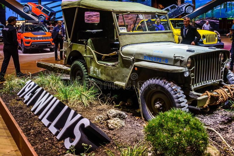 Vintage green army style Willy`s jeep from 1941. Geneva International Motor Show 2018, Jeep exhibition stand with green vintage army style Willy's jeep and stock photography