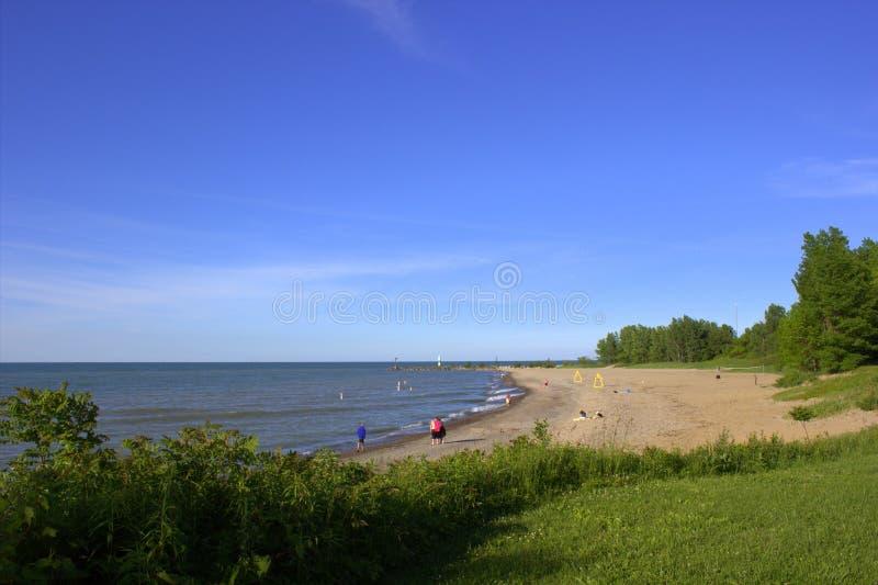 Sunny beach shoreline stock photos