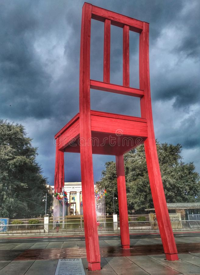 Geneva, Switzerland - February 5, 2017 - Gigantic Broken Chair. Photo of the giantical sculpture - Broken chair. Symbol of the fight against land mines and stock image