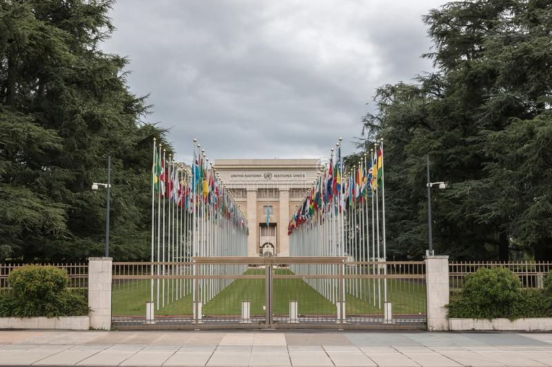 National flags at the entrance in UN office at Geneva, Switzerland stock images