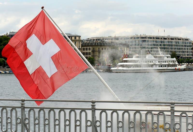 Geneva, Switzerland - June 05, 2017: Swiss Flag on the embankment in Geneva, Switzerland. stock photo