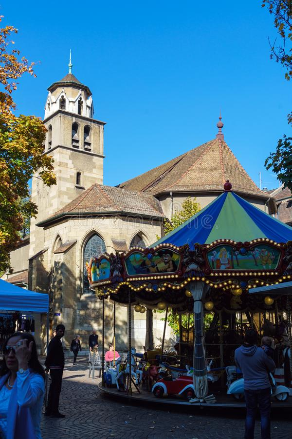 Geneva, Switzerland - October 18, 2017: Old Cathedral and merry-go-round royalty free stock photography