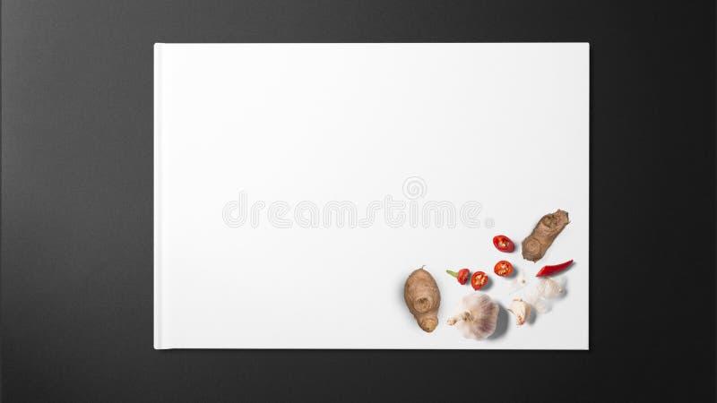 Gengibre, alho e pimenta vermelha no Livro Branco no fundo preto foto de stock royalty free