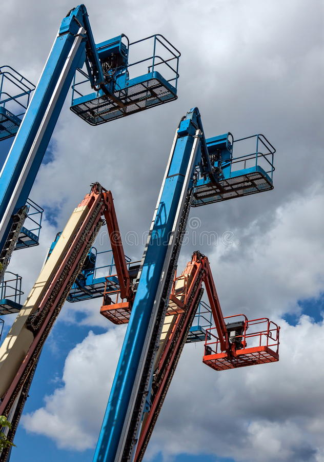 Genie booms for rent royalty free stock photo