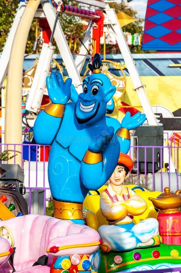 Genie och en pojke på karusellen royaltyfria foton