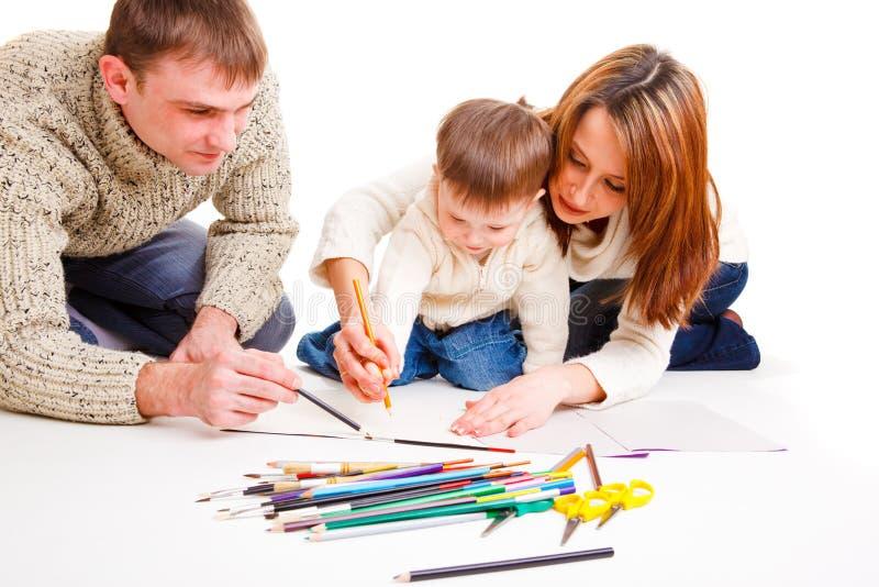 Genitori che dissipano con il figlio fotografia stock