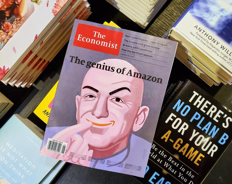 The genius of Amazon title and a picture of Jeff Bezos as the Dr Evil on The Economist royalty free stock photos