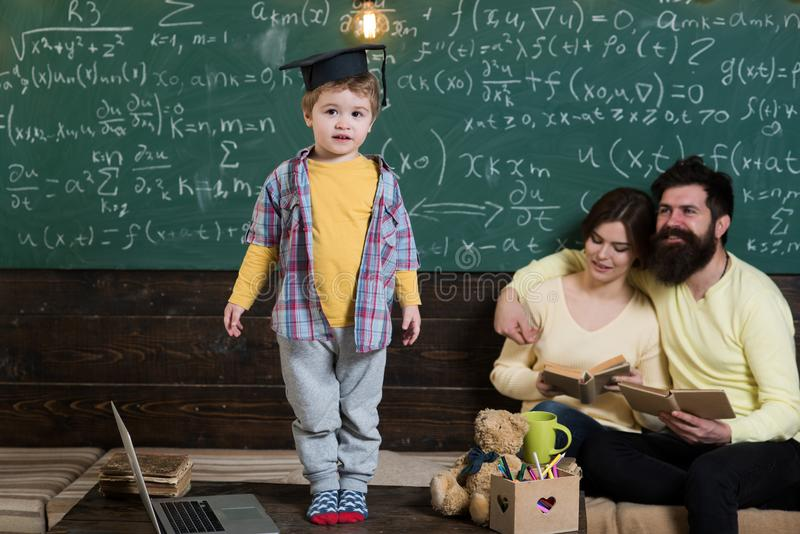 Genius child in graduation cap. Little genius answer hometask in classroom. Family proud of genius son. Genius without. Education is like silver in the mine stock images