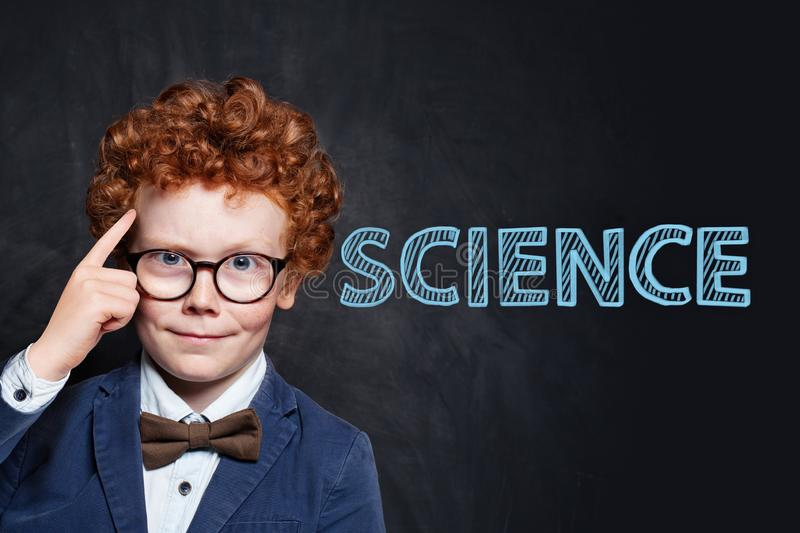 Genius child learning science. Genius child with red hair learning science royalty free stock photos