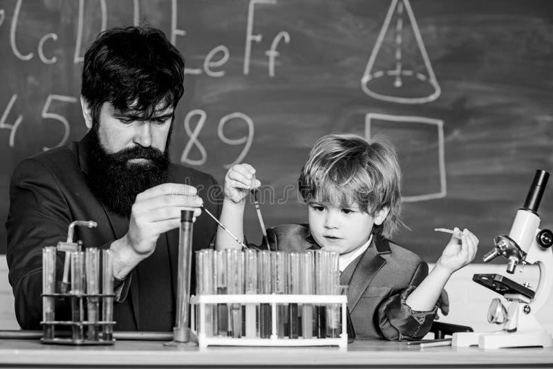 Genius minds. Genius toddler private lesson. Genius kid. Teacher child test tubes. Achieving developmental milestones. Way before predicted sign that child royalty free stock photos
