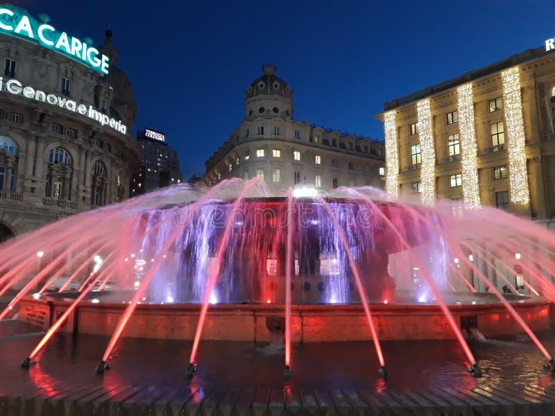 De Ferrari square at Christmas. Genoa, center of the city, De Ferrari square: the fountain coloured and illuminated for Christmas. Sweet and romantic atmosphere stock photo