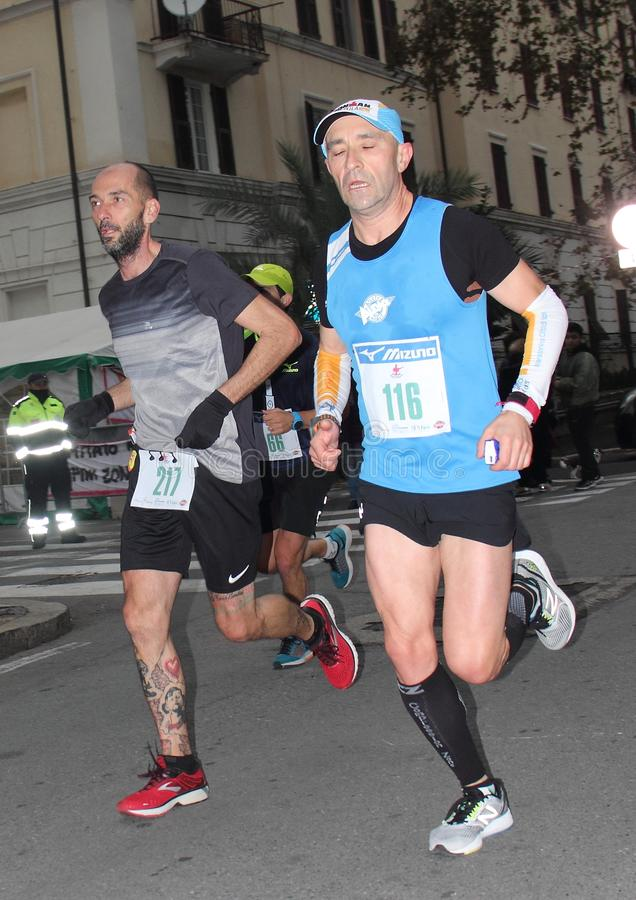 Genoa City Marathon running race on 2 December 2018. The race took place in Genoa to commemorate the victims of the collapse of the Morandi bridge on 14 August stock photography