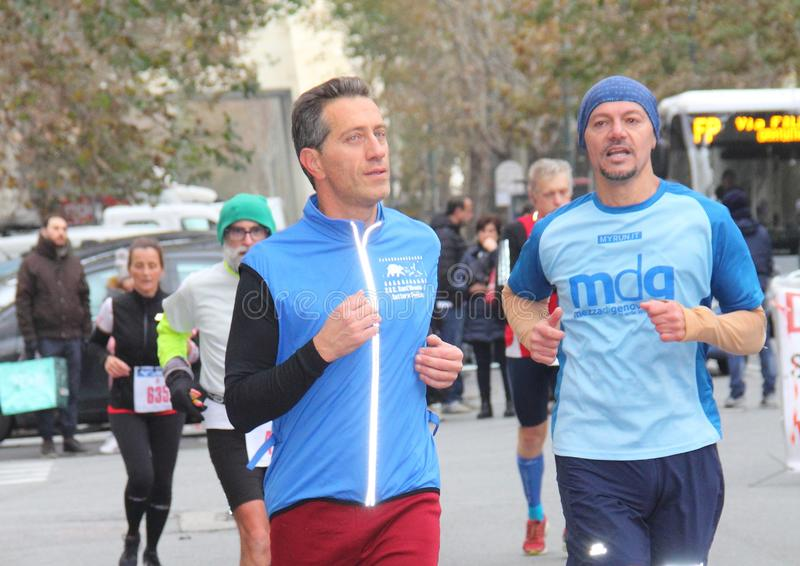 Genoa City Marathon running race on 2 December 2018. The race took place in Genoa to commemorate the victims of the collapse of the Morandi bridge on 14 August royalty free stock images