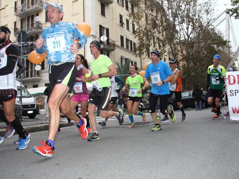 Genoa City Marathon running race on 2 December 2018. The race took place in Genoa to commemorate the victims of the collapse of the Morandi bridge on 14 August royalty free stock photo