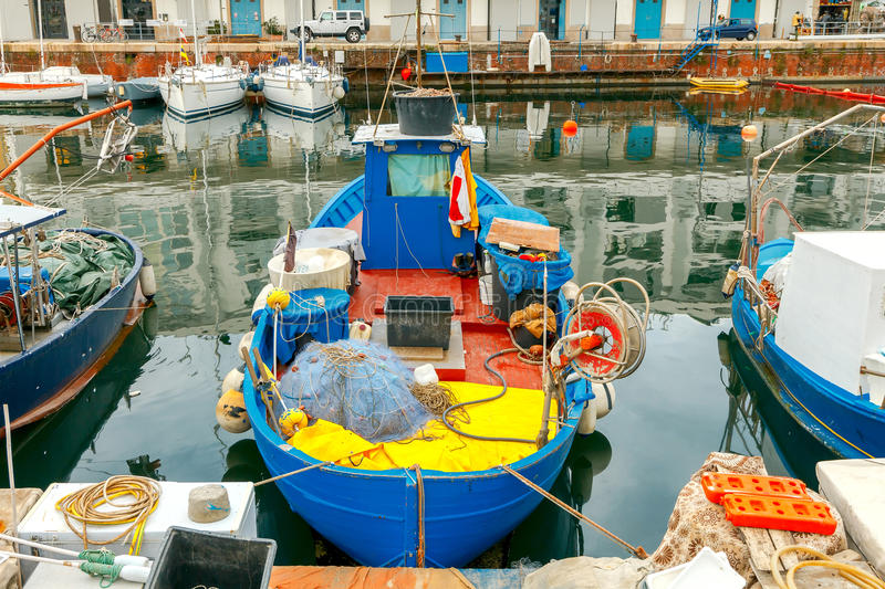 Genoa. Fishing boats in the seaport. Fishing multi-colored boats in the old port of Genoa. Italy stock image