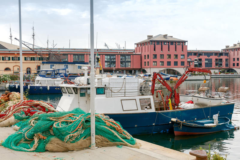 Genoa. Fishing boats in the seaport. Fishing multi-colored boats in the old port of Genoa. Italy stock images