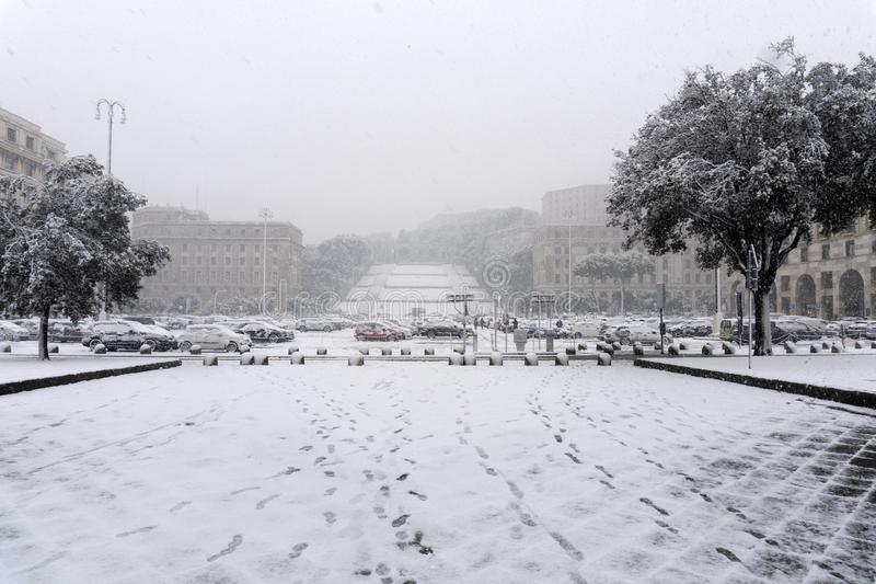 GENOA, ITALY - JANUARY 23 2019 - Town under the snow. GENOA, ITALY - JANUARY 23 2019 - It is very uncommon to sea the snow in the by the sea Liguria capital Town stock photos