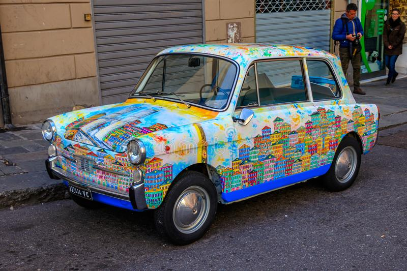 Colorful decorated vintage car with symbols of the city Genoa, Italy royalty free stock image