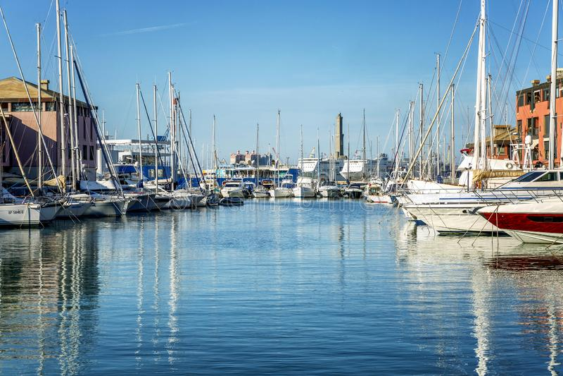 Genoa, Italy, 10/05/2019: Marina in a European city with white yachts on a bright sunny day. Beautiful seascape stock photo