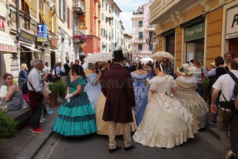 GENOA, ITALY - MAY 5 2018 - 19 century dress parade for Euroflora Exhibit in the unique scenario of the Nervi. GENOA, ITALY - MAY 5 2018 - 19 century dress stock images