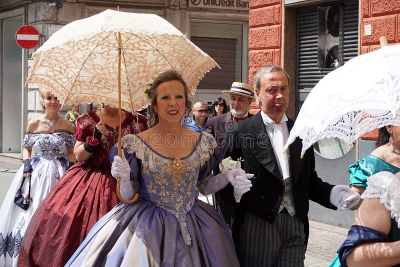 GENOA, ITALY - MAY 5 2018 - 19 century dress parade for Euroflora Exhibit in the unique scenario of the Nervi. GENOA, ITALY - MAY 5 2018 - 19 century dress stock image