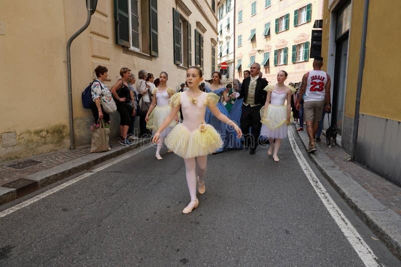 GENOA, ITALY - MAY 5 2018 - 19 century dress parade for Euroflora Exhibit in the unique scenario of the Nervi. GENOA, ITALY - MAY 5 2018 - 19 century dress stock photos