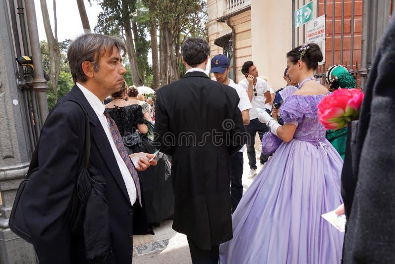 GENOA, ITALY - MAY 5 2018 - 19 century dress parade for Euroflora Exhibit in the unique scenario of the Nervi. GENOA, ITALY - MAY 5 2018 - 19 century dress royalty free stock photo