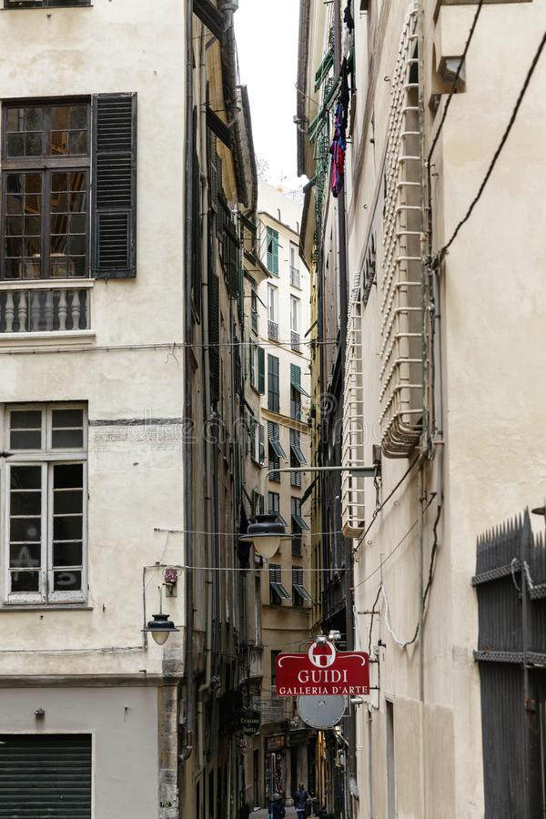 Genoa, Italy, 10/04/2019: Narrow street with old houses in the old city. royalty free stock photos
