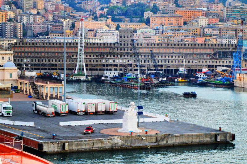 Genoa, Italy - October 13, 2018: Panorama of the old port with port cranes, pier, trucks, sea view, early morning, dusk and the royalty free stock photo
