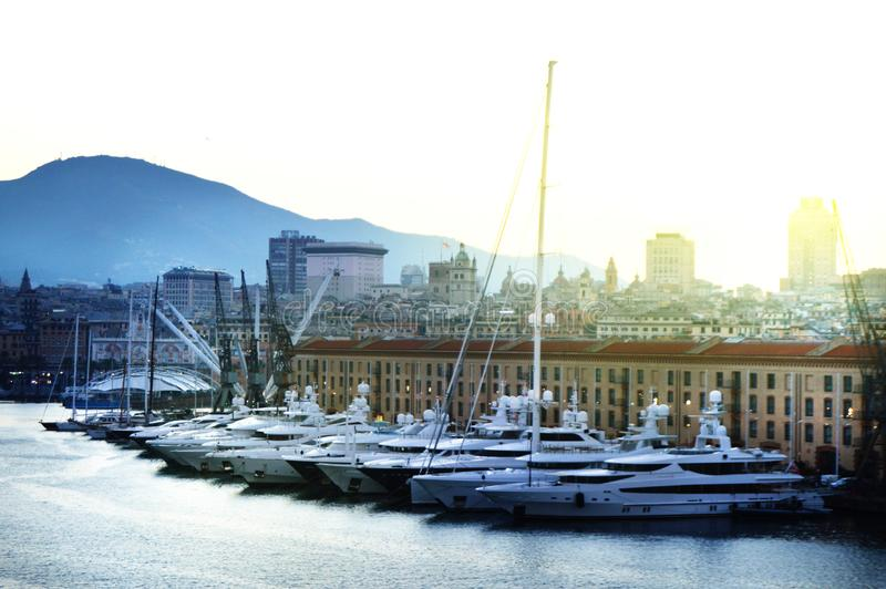Genoa, Italy-October 13, 2018: panorama of the old port with harbour cranes, pier, yachts, sea view, early morning, dusk and early stock images