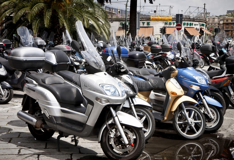 Genoa, Italy- scooter parking in city center royalty free stock photography