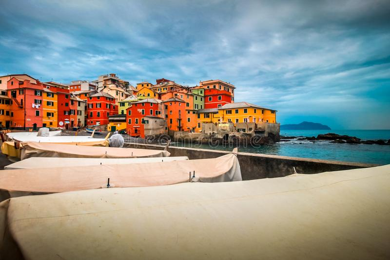 Genoa landmark Boccadasse old traditional fishing village. Italy Genoa, Boccadasse district genoese with fishermen boats and colorful residential architecture