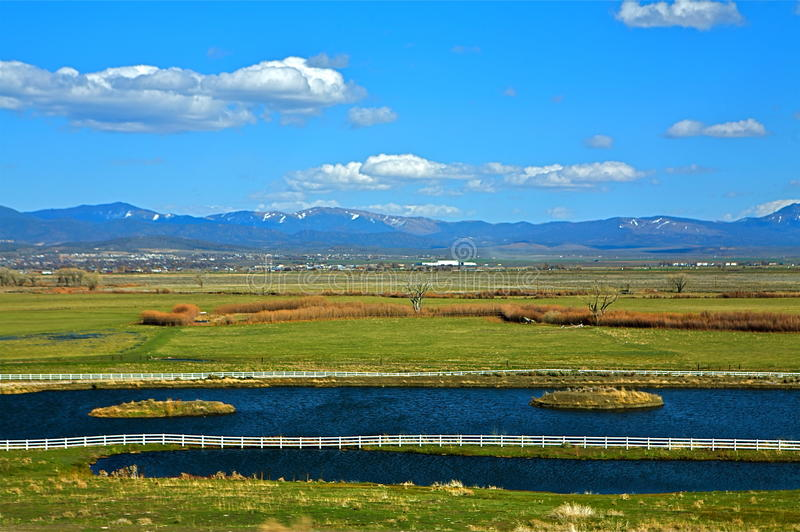 Genoa, Nevada. Genoa is in the township of Douglas County Nevada. It is situated within Carson Valley and is about 42 miles (68 km) south of Reno. Here the green stock photo